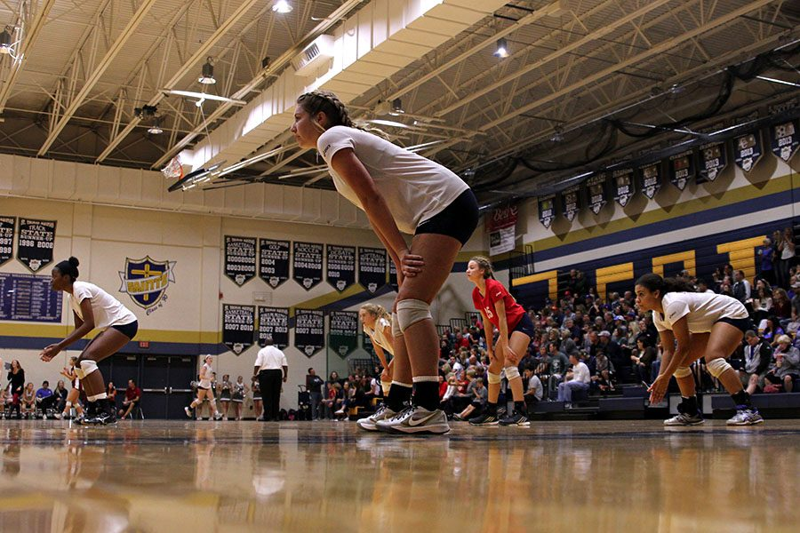 While+waiting+for+their+opponents+to+serve%2C+the+team+prepares+on+Saturday%2C+Oct.+22.+The+Jaguars+beat+Sumner+Academy+but+fell+to+St.+Thomas+Aquinas+in+the+second+round.++