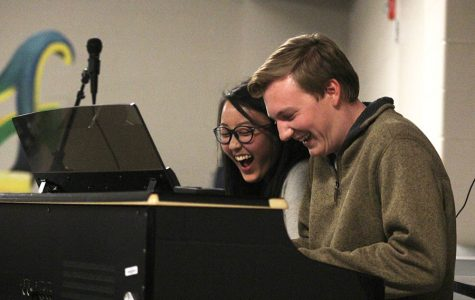 During Open Mic Night on Monday, Nov. 28, seniors Sue Kim and Brady Rolig play the piano together while laughing.