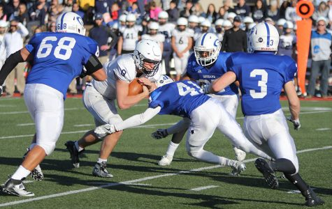 Pushing through the Goddard defense, senior Ben Hartman carries the ball.