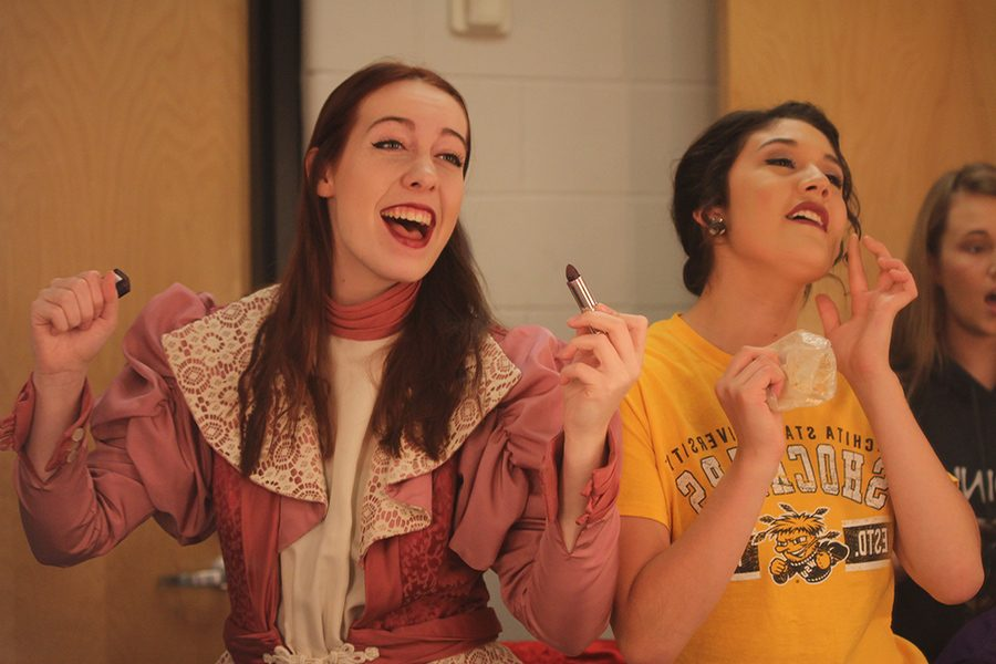 Before+dress+rehearsal+of+the+Carol+cast%2C+seniors+Lisa+Earlenbaugh+and+Natalie+Carrera+put+on+their+stage+makeup.+