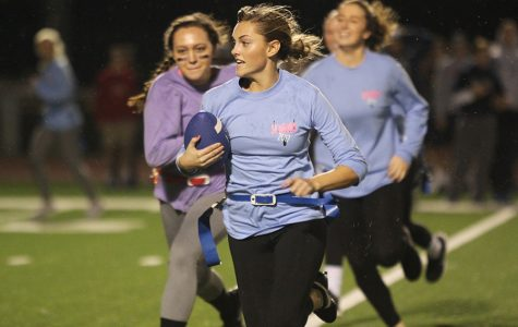 Senior Sydney Hookstra runs the ball down the field.