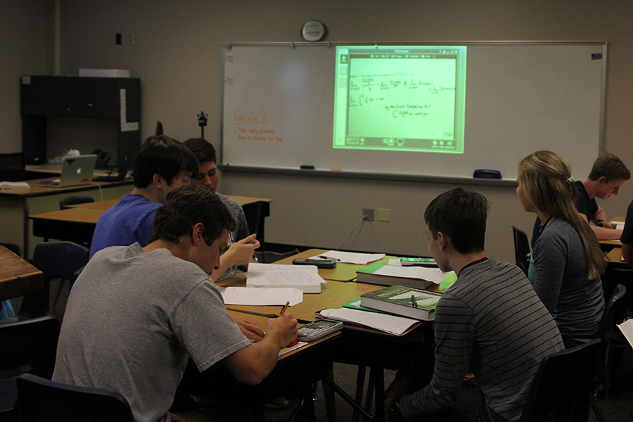Mill Valley students work on assignments while math teacher Brian Rodkey's notes are displayed on a screen.