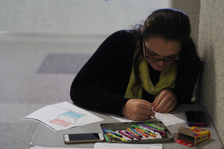 Sophomore Makayla King colors on a worksheet in honor of National French Week on Wednesday, Nov. 9.