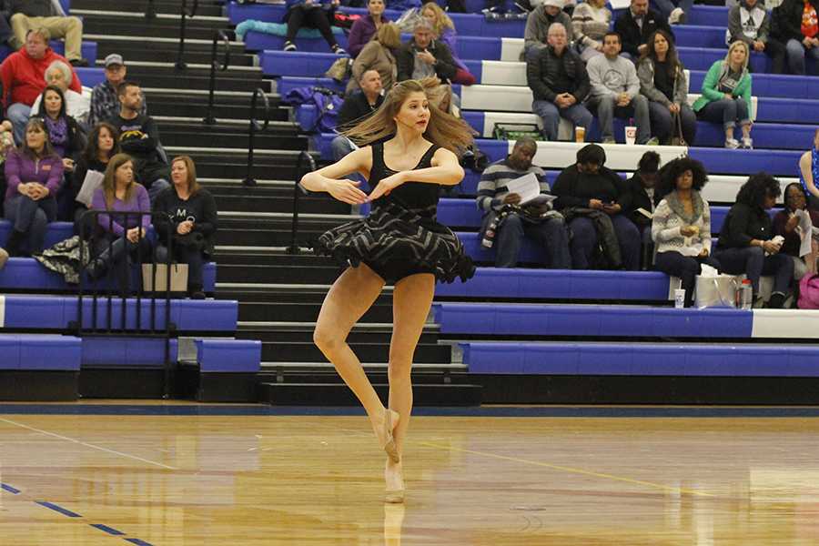 Spinning+in+her+pirouette%2C+sophomore+Addie+Ward+performs+her+solo.