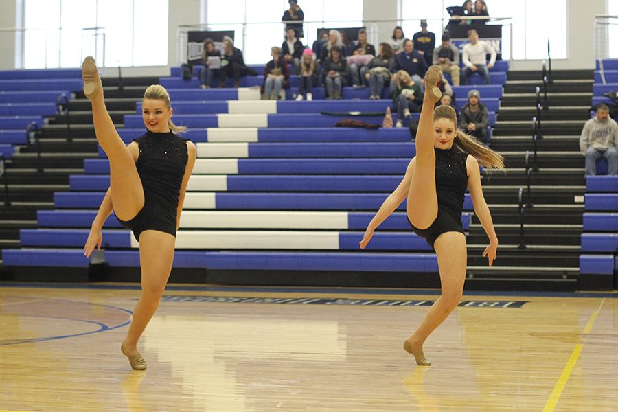 Kicking+forward%2C+juniors+Abby+Sutton+and+Emmy+Bidnick+perform+their+junior+duet.+The+ensemble+placed+sixth+overall+in+the+11th+grade+division.