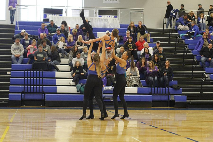Lifting+senior+Julia+Kemp+into+the+air%2C+other+Silver+Stars+seniors+spin+during+the+senior+ensemble.