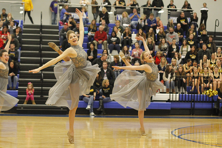 Sophomores+Addie+Ward+and+Bella+Line+smile+widely+during+the+jazz+routine.