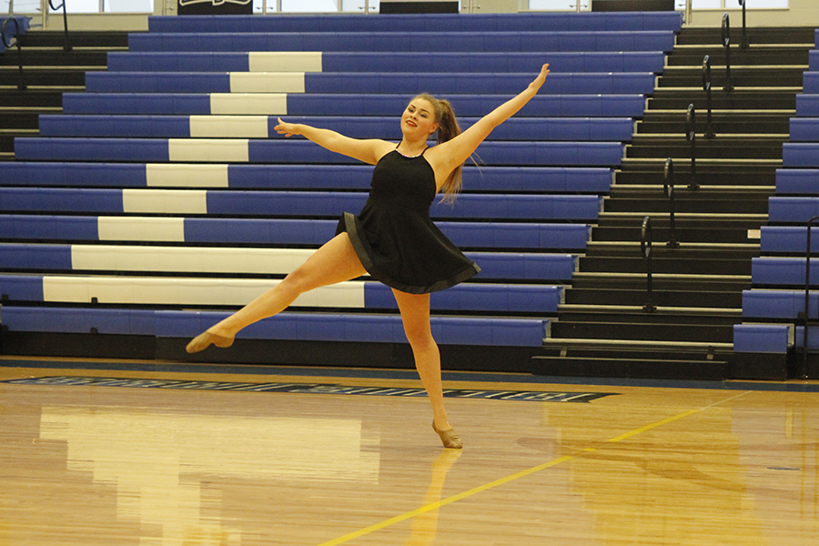 Gliding+across+the+floor%2C+senior+Paige+Habiger+performs+her+solo.+Her+solo+placed+fourth+in+the+senior+solo+division.