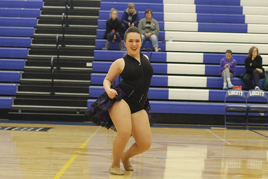 Sophomore+Eve+Steinle+pops+her+hip+during+her+solo.
