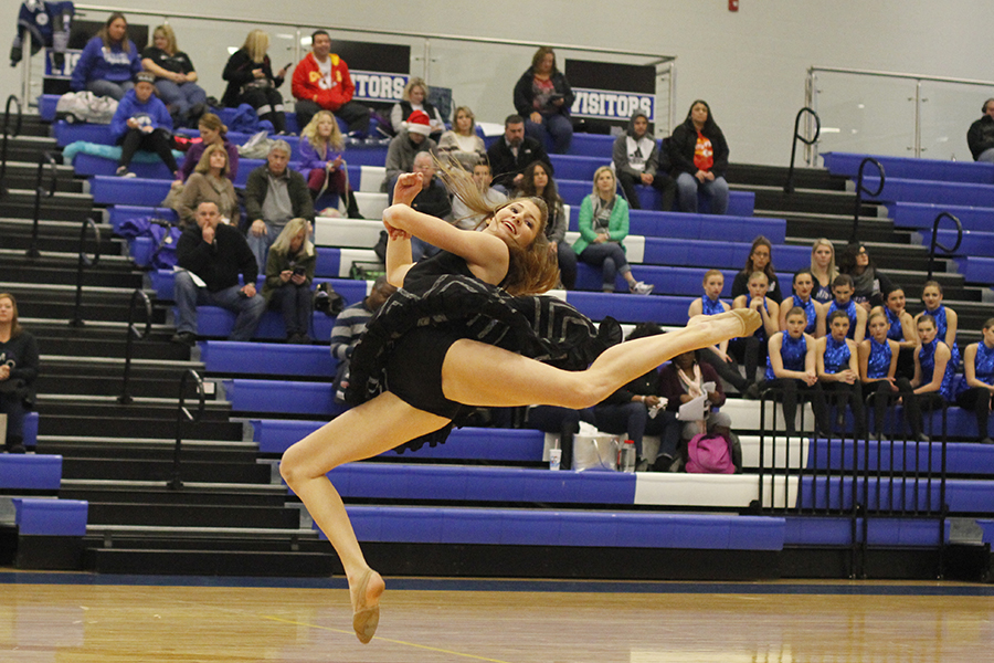 Leaping+into+their+air%2C+sophomore+Addie+Ward+performs+her+solo.
