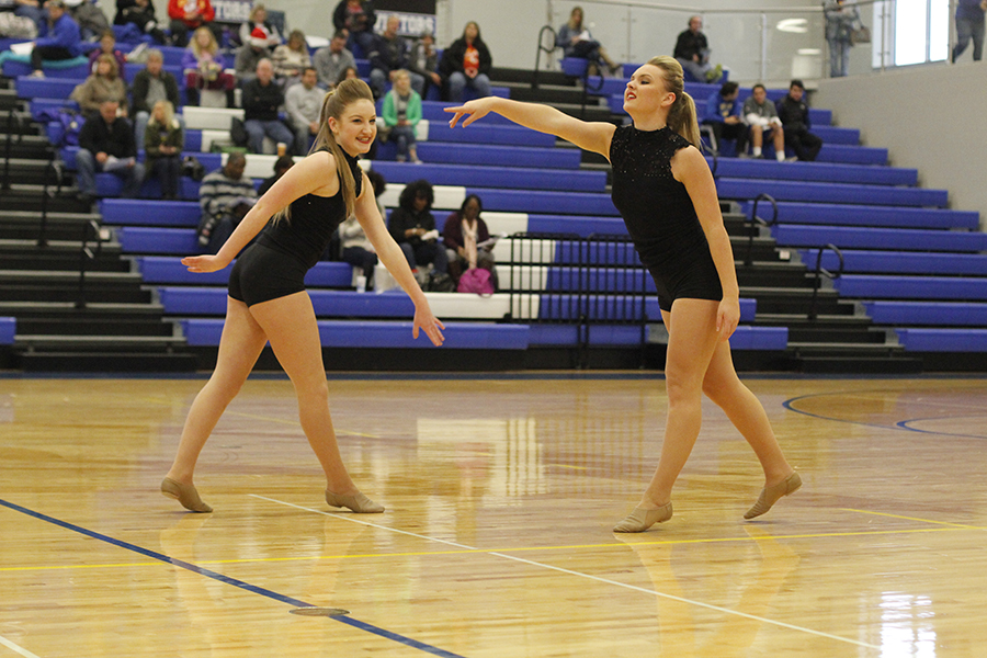 Stepping+towards+each+other%2C+juniors+Abby+Sutton+and+Emmy+Bidnick+perform+their+junior+duet.