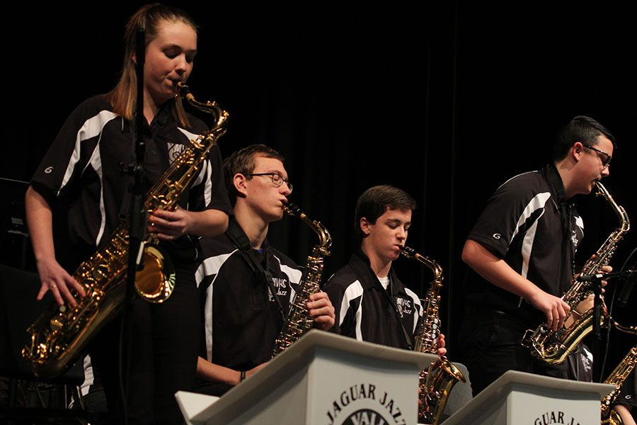 Junior Dakota Wilson and senior Collin Petigna stand up for their saxophone duet portion of the piece.