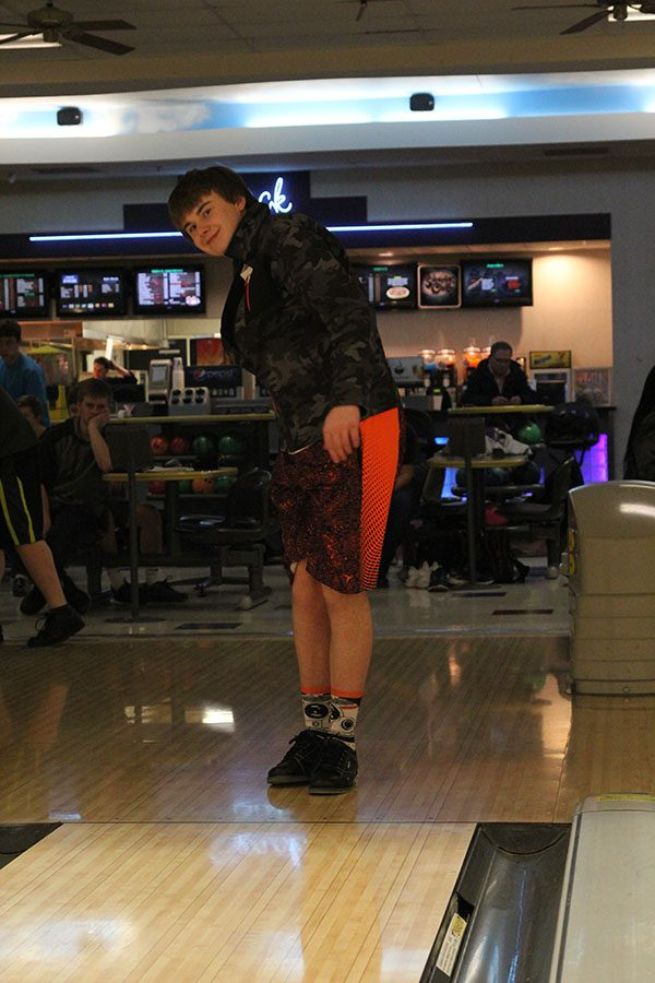 Sophomore+Ethan+Lancaster+smiles+as+he+watches+his+ball+go+down+the+lane.