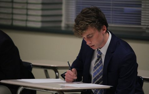 Preparing for roleplay, senior Jakob Coacher organizes his ideas on Wednesday, Jan. 11.