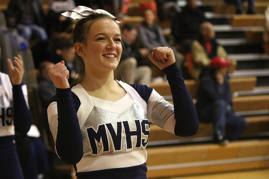 Senior Brianna Duden cheers on the team.