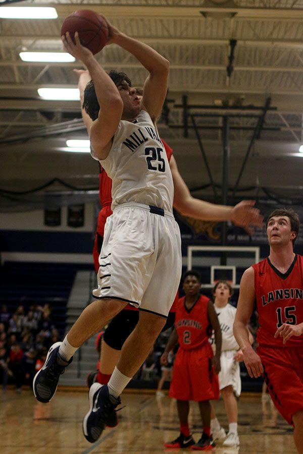 Junior Ike Valencia jumps for a basket.