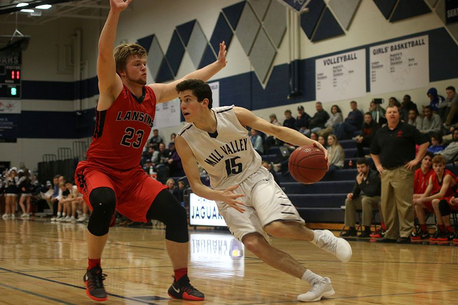 Junior Mason Little dribbles down the court towards the basket.