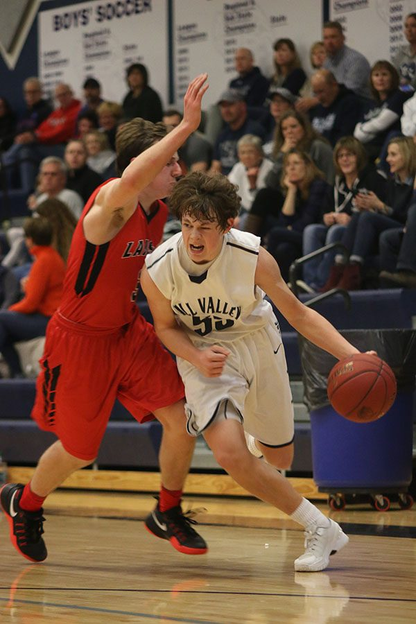 Sophomore Tanner Moore dribbles past his opponent.