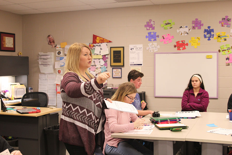 Family and Consumer Sciences teacher Emily Schmidt observes her students as she teaches them SMART goals, which are life planning skills.