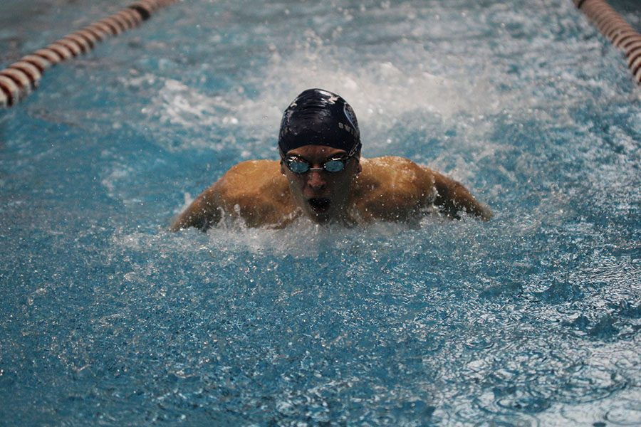 In+the+200+yard+medley+relay%2C+junior+Carter+Lawson+performs+the+butterfly+on+Thursday%2C+Jan.+26.