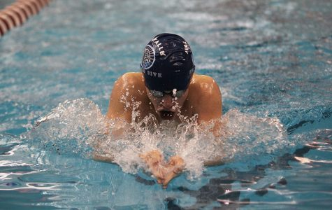 In the Individual Medley, sophomore Chris Sprenger performs the breast stroke at the Blue Valley West on Thursday, Jan 26.