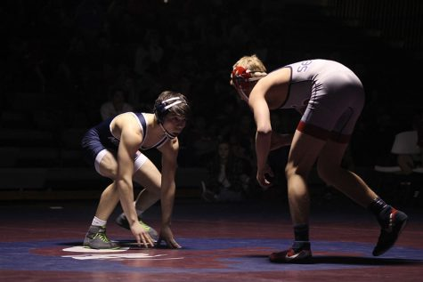 Wrestling splits in a three-team dual