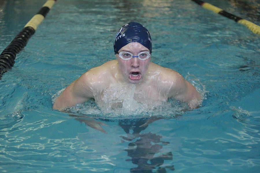 As he reaches the end of his lane, sophomore Jakob Twigg breaststrokes to the finish  on Monday, Jan. 9.