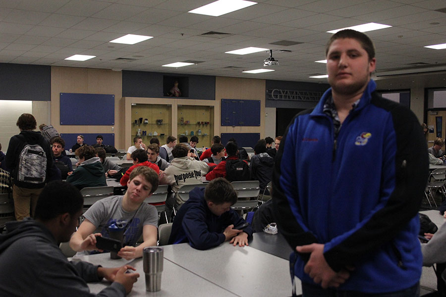 Senior Jacob Campbell enjoys spending time in the cafeteria with his fellow football teammates after morning workouts.