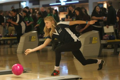 While bowling, junior Bella Hadden releases her bowling ball.