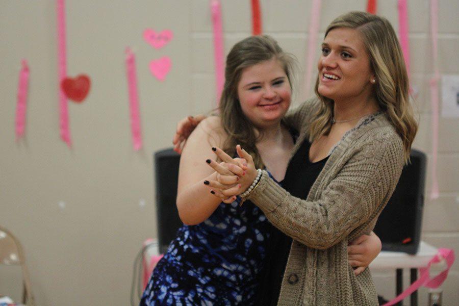 Senior Sidney Lawyer dances with freshman Maria McElwee.