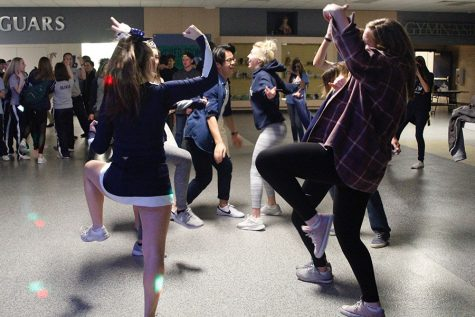 Students stay after boys basketball game for Winter Homecoming dance
