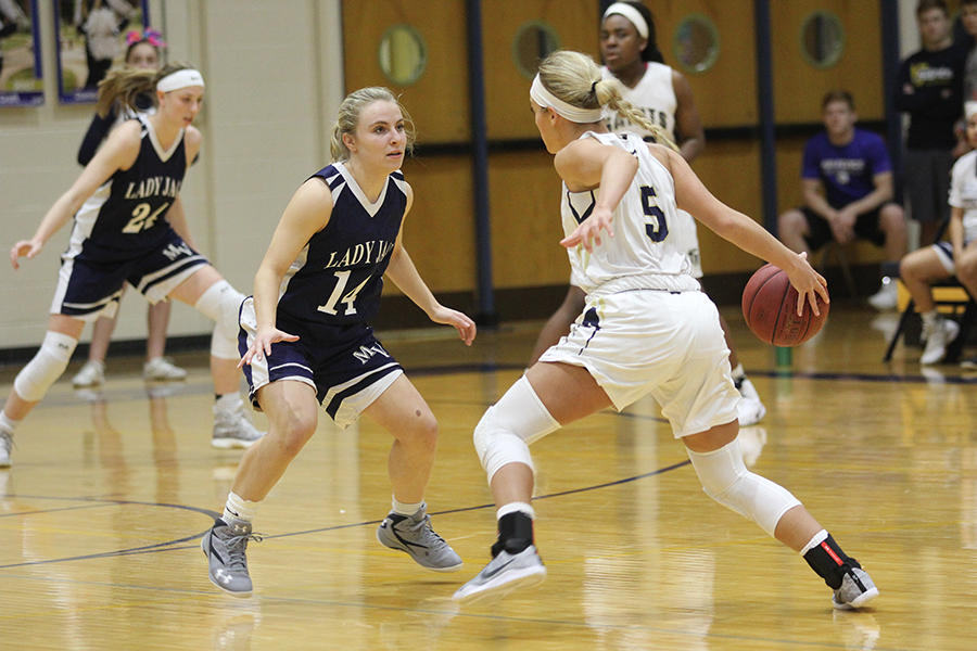 On Friday, Feb. 10, the Lady Jags lose an away game to St. Thomas Aquinas 36-52. During the first quarter, junior Adde Hinkle guards her opponent.