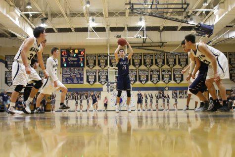 Boys basketball team falls to St. Thomas Aquinas
