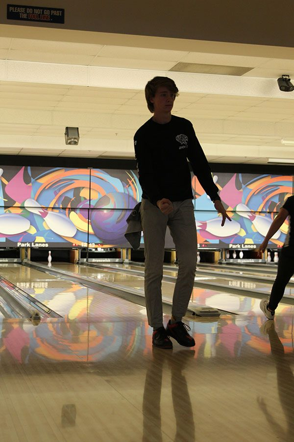 Walking+back+from+bowling+a+strike%2C+senior+Spencer+Butterfield+celebrates+at+Park+Lanes+on+Monday%2C+Feb.+13.+The+girls+team+placed+first+at+the+meet.