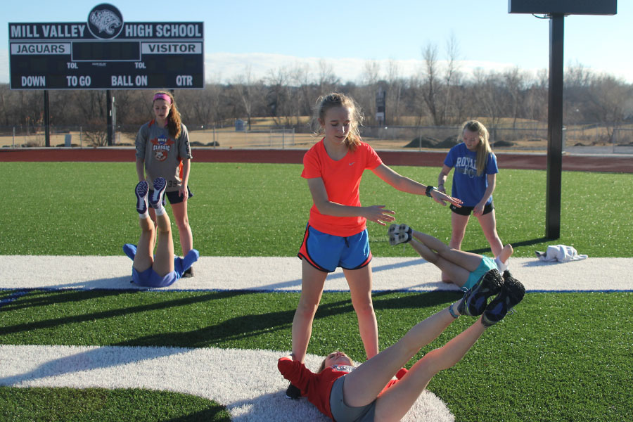 During soccer winter training freshman Emerson Kaiser workout with freshman Morgan Kocas on Wednesday, Jan. 18.
