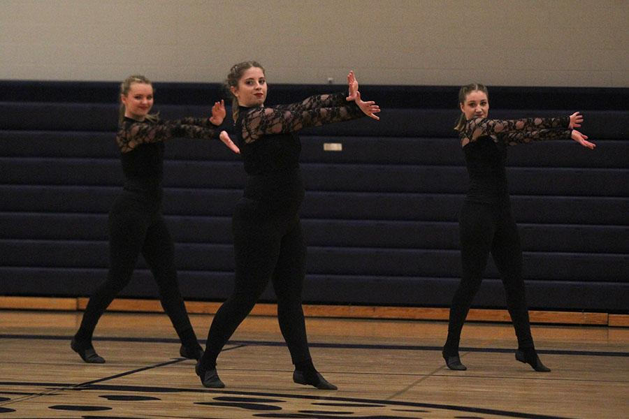 Juniors+Emmy+Bidnick%2C+Emma+Barge+and+Abby+Sutton+dance+during+the+junior+ensemble.