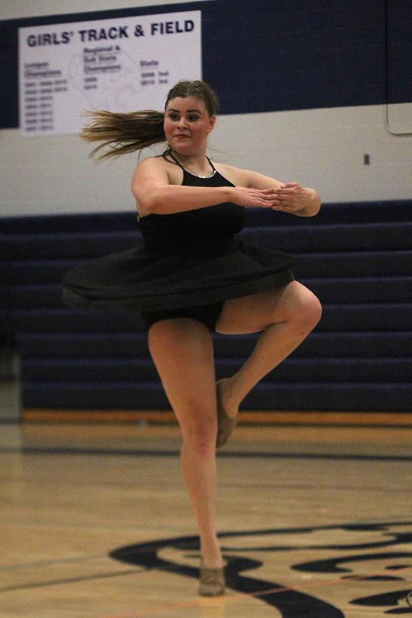 Senior+Paige+Habiger+does+a+pirouette+during+her+solo.