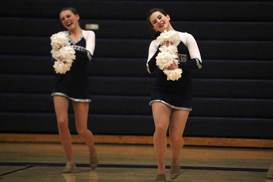 Senior+Julia+Kemp+and+sophomore+Olivia+Augustine+dance+during+the+pom+routine.