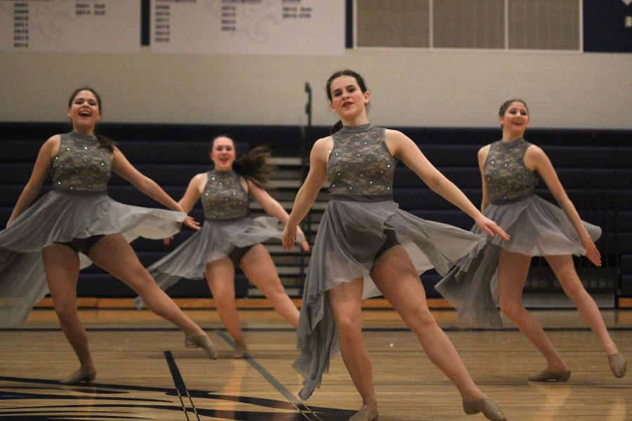 Freshman+Samantha+Pennington%2C+sophomores+Eve+Steinle%2C+Olivia+Augustine+and+Addie+Ward+dance+during+the+lyrical+jazz+routine.