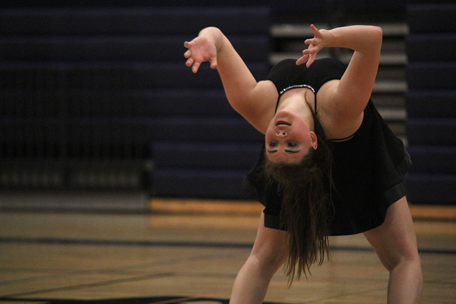 Bent+backwards%2C+senior+Paige+Habiger+performs+her+solo.