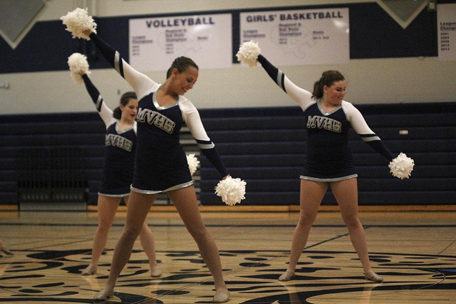 Sophomore+Olivia+Augustine%2C+seniors+Lauren+Schath+and+Paige+Habiger+dance+in+the+pom+routine.