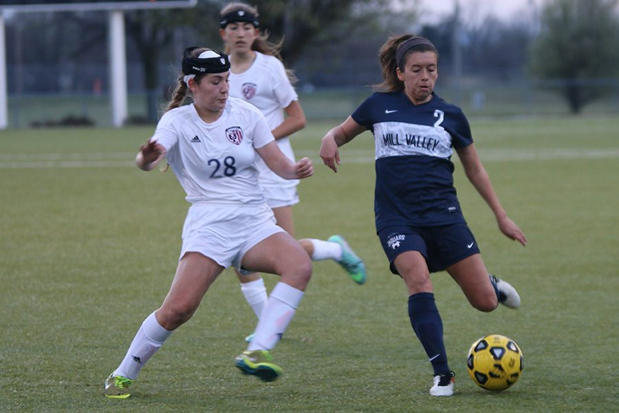 Senior Haley Freeman prepares to kick the ball away from her opponent.