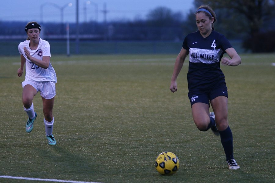 After receiving the ball, freshman Ella Shurley prepares to pass it downfield.
