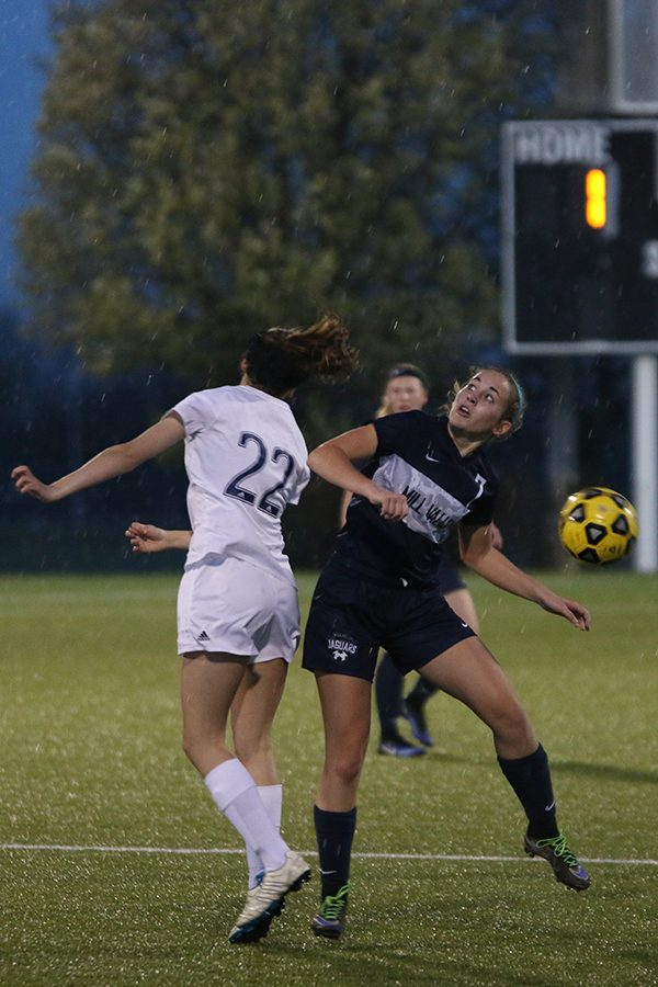 Junior Madison Irish looks for the ball after it was kicked upfield.