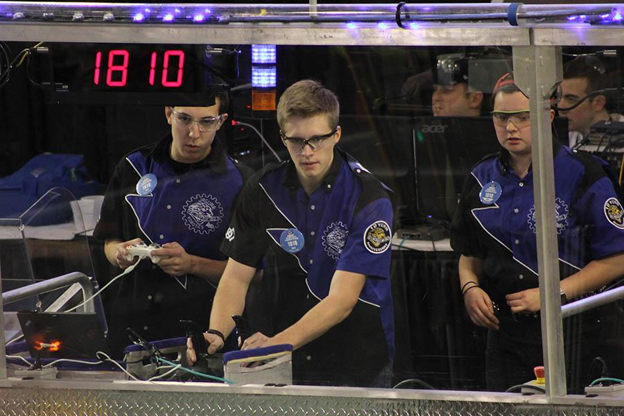 During their quarterfinals match at the Greater Kansas City Regional on Saturday, March 18, seniors Jacob Tiehen and Marc Hinnen focus on driving the robot.