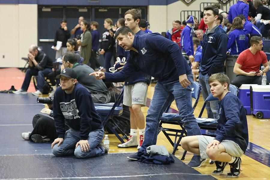 During+an+intense+wrestling+match%2C+head+coach+Travis+Keal+stands+to+direct+a+%0Awrestler+to+assist+them+in+winning+their+match+on+Saturday%2C+Feb.+11.