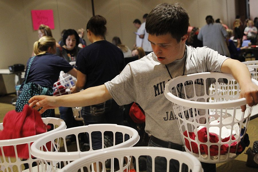Sophomore Matt Santaularia sorts red, white and blue towels during the laundry sorting event.