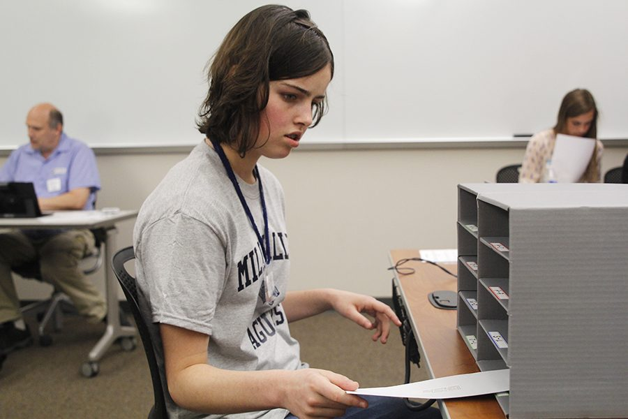 During the letter sorting event, sophomore Karsyn Aylward puts letters into their respective boxes.