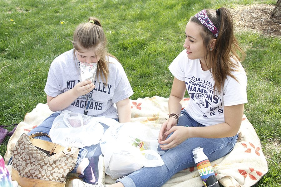 Senior Haley Pultz and freshman Maria McElwee have a picnic during their lunch break.