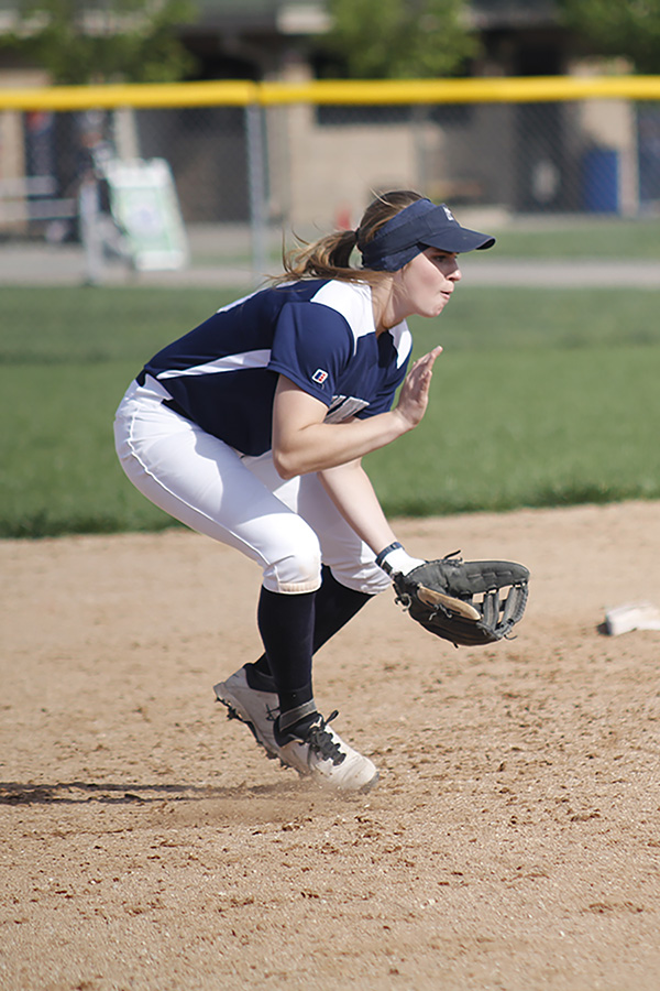 Bending+down%2C+senior+Christin+Kelly+prepares+to+catch+a+softball+during+a+double-header+against+Miege.